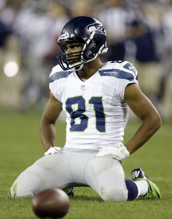 Seattle Seahawks' Golden Tate reacts after an incomplete pass during the second half of an NFL preseason football game against the Green Bay Packers Friday, Aug. 23, 2013, in Green Bay, Wis. (AP Photo/Jeffrey Phelps) Photo: AP