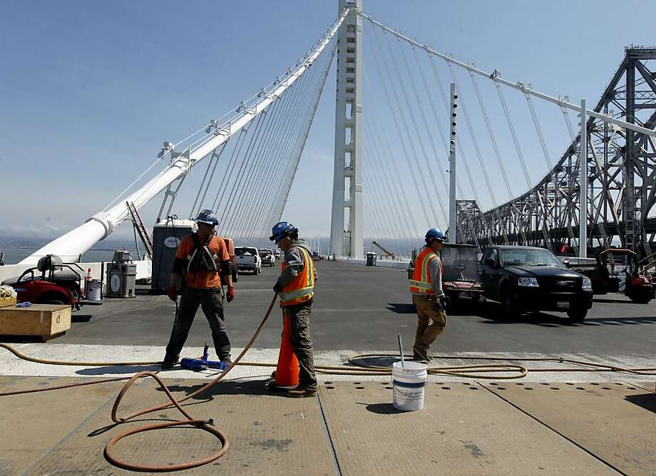 Construction crews wrap up work on the new eastern span of the Bay Bridge to prepare it for its Sept. 3 opening. Photo: Paul Chinn, The Chronicle