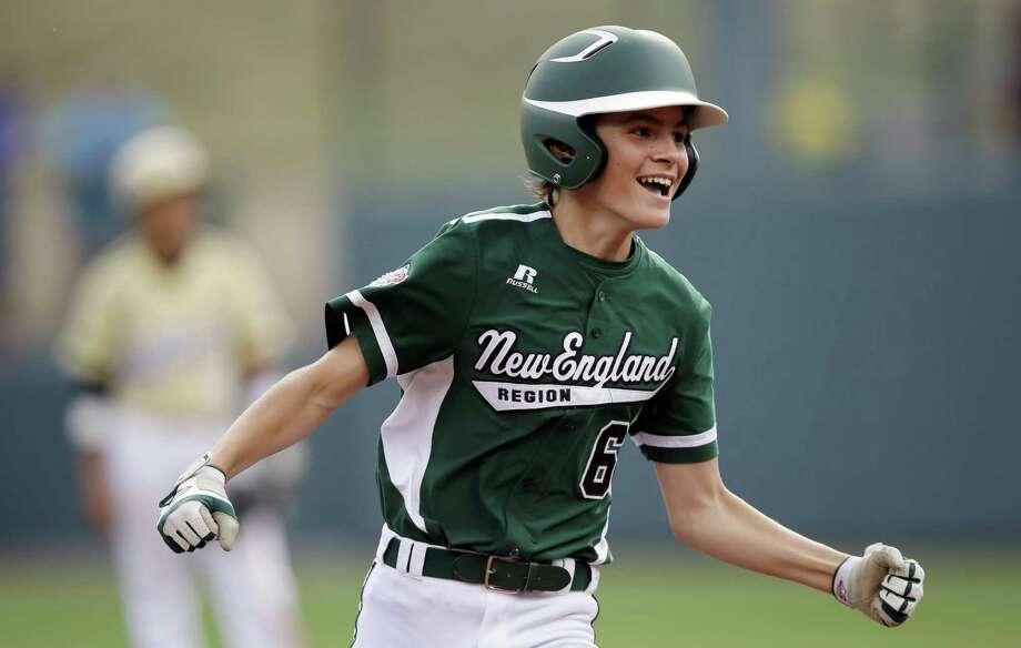 Connecticut's Max Popken smiles after hitting a two-run home run in the team's game-tying, seven-run fifth inning against Washington. Photo: Matt Slocum / Associated Press