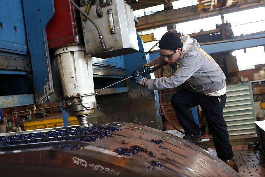 An XKT worker carves out grooves for the the saddles that will fix the broken bolt problem on the Bay Bridge during a media tour of the XKT Engineering facilities in Vallejo, Calif. on July 31, 2013. Photo: Ian C. Bates, The Chronicle