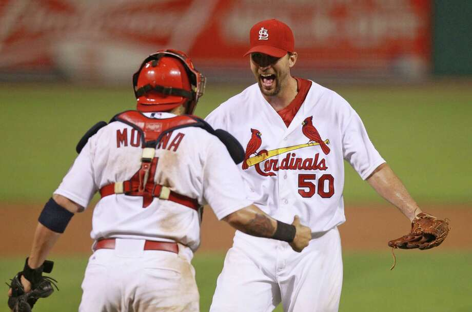 Catcher Yadier Molina, left, and starter Adam Wainwright were in sync Friday night, teaming up for a complete game in the Cardinals' win over the Braves. Photo: Chris Lee, MBR / St. Louis Post-Dispatch