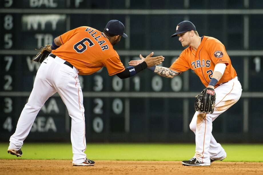 Aug. 23: Astros 12, Blue Jays 4  Astros shortstop Jonathan Villar and center fielder Brandon Barnes celebrate after the final out. Photo: Smiley N. Pool, Houston Chronicle