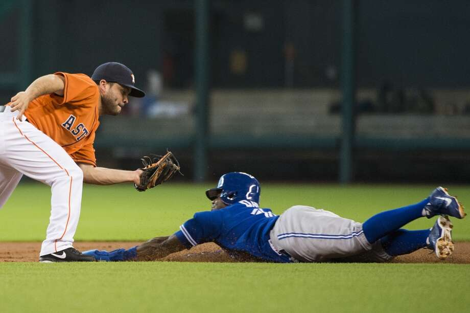 Astros second baseman Jose Altuve applies the tag as Blue Jays left fielder Rajai Davis is caught stealing. Photo: Smiley N. Pool, Houston Chronicle