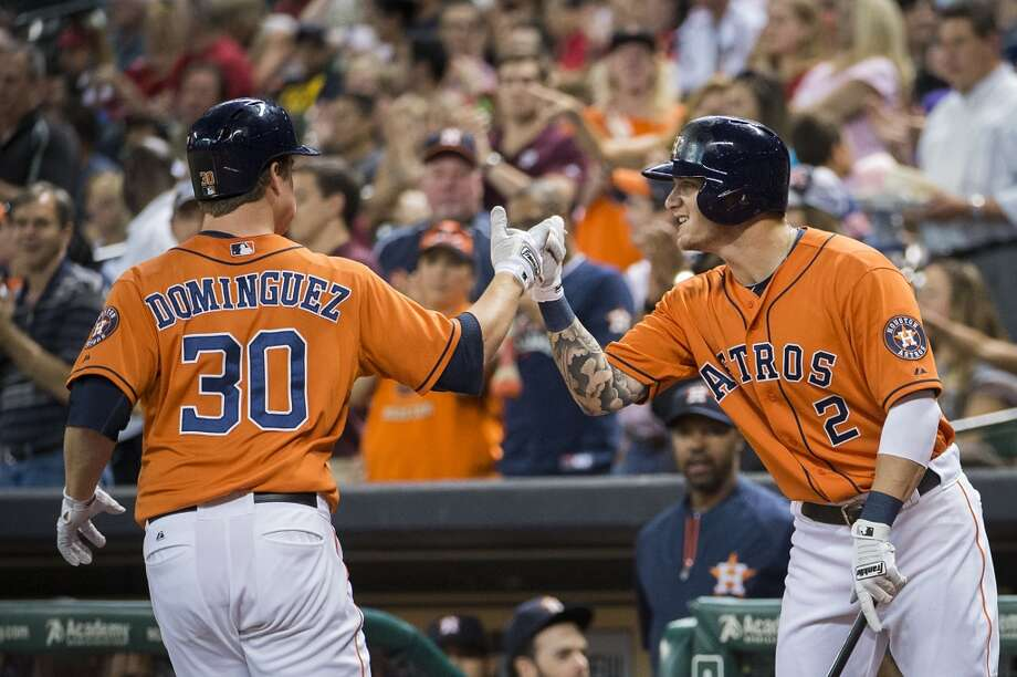 Astros third baseman Matt Dominguez celebrates with center fielder Brandon Barnes after hitting a home run. Photo: Smiley N. Pool, Houston Chronicle