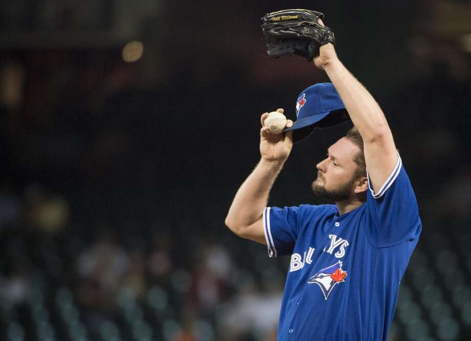 Blue Jays starting pitcher Todd Redmond adjusts his cap after giving up a double to Jose Altuve. Photo: Smiley N. Pool, Houston Chronicle