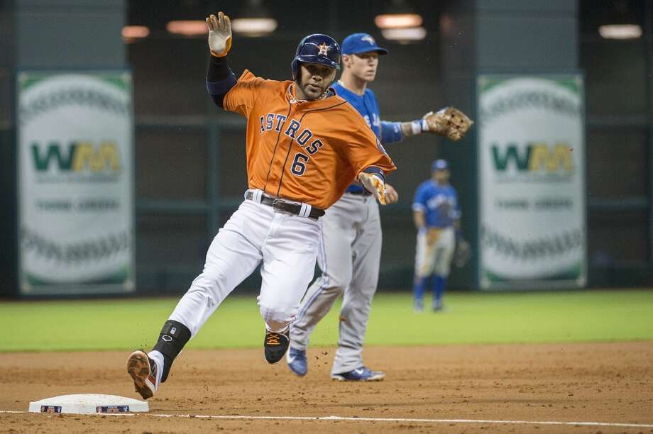Astros shortstop Jonathan Villar puts on the brakes as he is safe at third base with a triple. Photo: Smiley N. Pool, Houston Chronicle