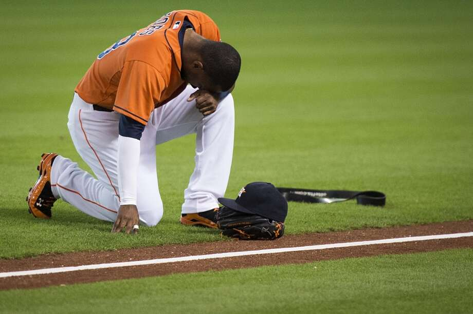 Astros left fielder L.J. Hoes kneels in prayer before the game. Photo: Smiley N. Pool, Houston Chronicle