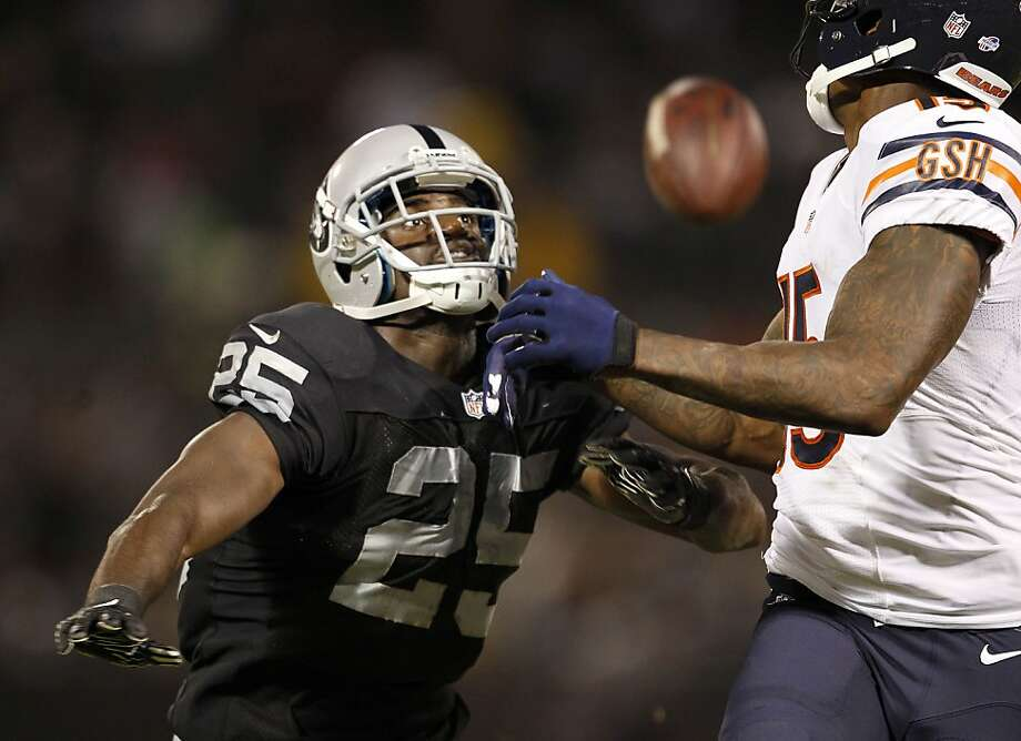D.J. Hayden, left, breaks up a pass to Brandon Marshall in his first game for Oakland. Photo: Michael Macor, San Francisco Chronicle