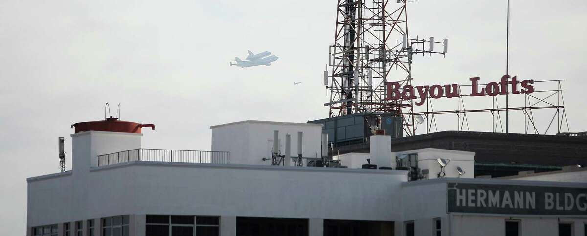 The space shuttle Endeavour flies over Bayou Lofts in 2012. The downtown building has 106 condo units.