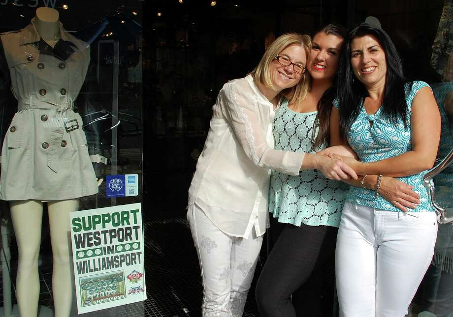 At The Brownstone on Main Street, Victoria Schallert, Niki Puglisi and co-owner Celeste Puglisi have found the spirit of support for the local Little League team baseball contagious.  WESTPORT NEWS, CT 8/23/13 Photo: Jarret Liotta / Westport News contributed