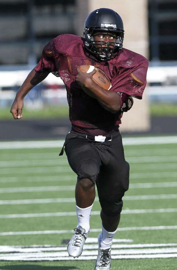 George Ranch running back Collins Quibena finds daylight as the Longhorns scrimmaged Morton Ranch at Traylor Stadium in Rosenberg on August 23, 2013. Photo by Diana L. Porter Photo: Diana L. Porter / © Diana L. Porter