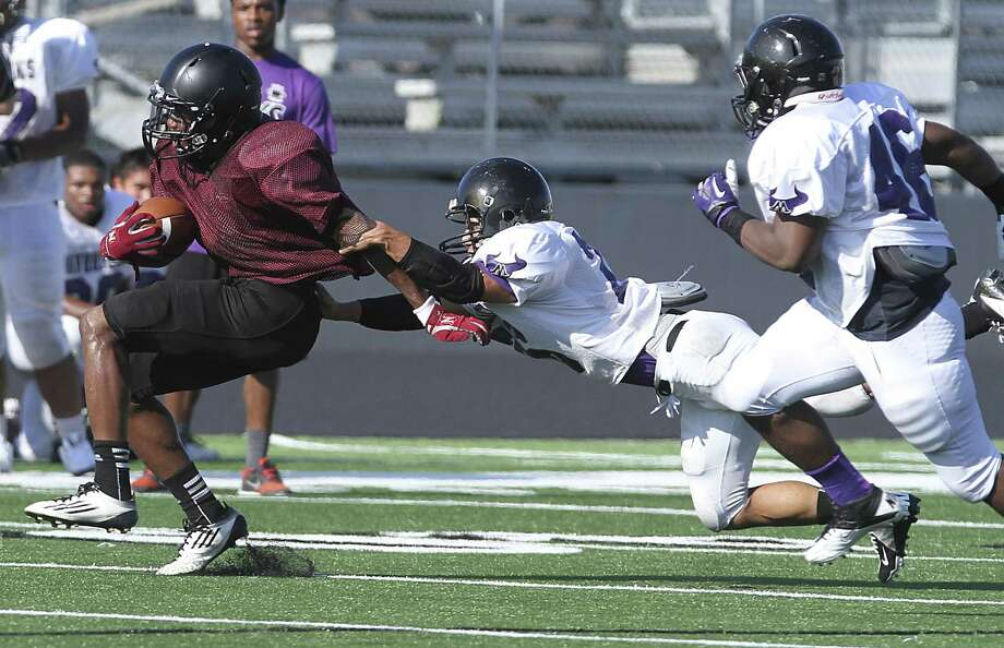 George Ranch running back Darius Anderson gets taken down by Luis Cassani of Morton Ranch as the Longhorns scrimmaged Morton Ranch at Traylor Stadium in Rosenberg on August 23, 2013. Photo by Diana L. Porter Photo: Diana L. Porter / © Diana L. Porter
