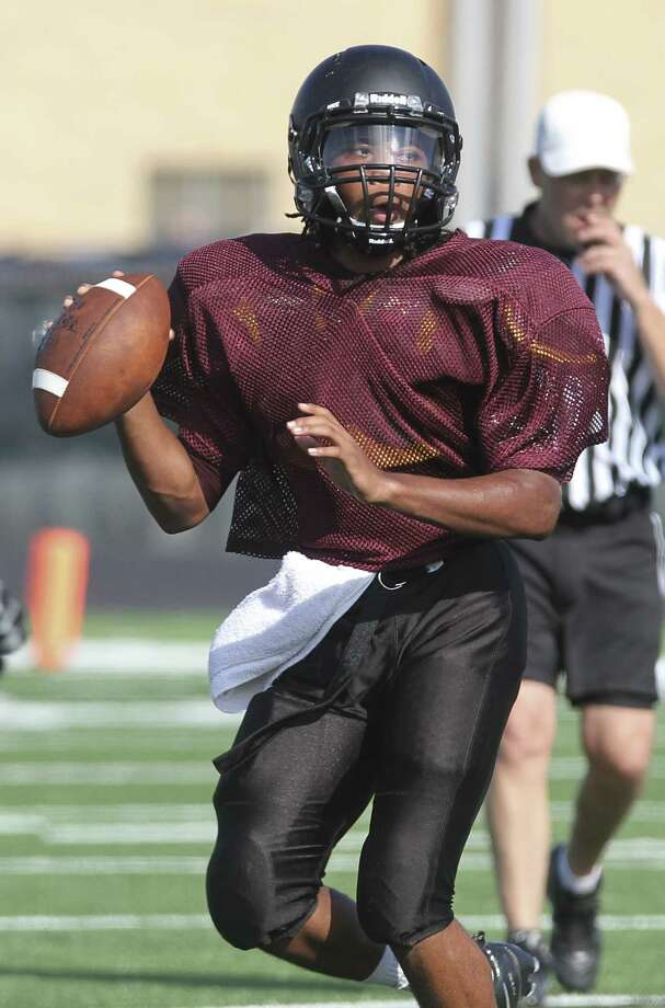 George Ranch quarterback Timon Nolan looks for an open receiver during a Friday morning scrimmage with Morton Ranch at Traylor Stadium in Rosenberg on August 23, 2013. Photo by Diana L. Porter Photo: Diana L. Porter / © Diana L. Porter