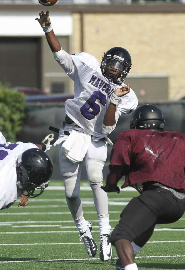 Morton Ranch quarterback Javon Cole fires off the ball as the Mavericks scrimmaged George Ranch at Traylor Stadium in Rosenberg on August 23, 2013. Photo by Diana L. Porter Photo: Diana L. Porter / © Diana L. Porter