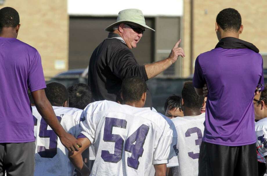 Morton Ranch head coach Dave Meadows talks with his team before their scrimmage with George Ranch at Traylor Stadium in Rosenberg on August 23, 2013. Photo by Diana L. Porter Photo: Diana L. Porter / © Diana L. Porter