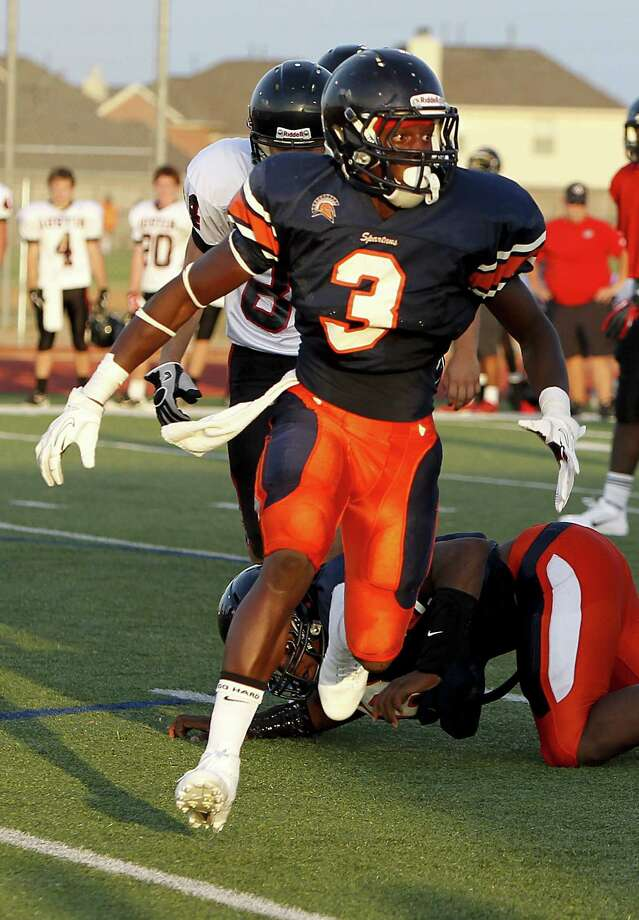 Seven Lakes' Bright Ugwoegbu goes after the ball carrier as the Spartans scrimmaged Ft. Bend Austin at Seven Lakes HS in Katy, TX on August 23, 2013. Photo by Diana L. Porter Photo: Diana L. Porter, For The Chronicle / © Diana L. Porter