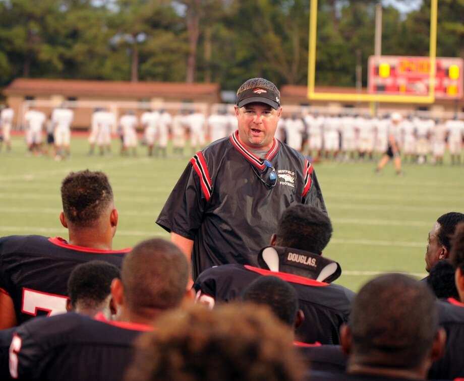 Westfield coach Corby Meekins speaks to his team before a scrimmage game. Photo: Eddy Matchette, For The Chronicle / Freelance