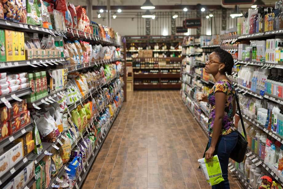 Kierra Fulks, 77042, checking out the aisle at the new Fresh Market on San Felipe near Post Oak.  Photo: R. Clayton McKee, For The Chronicle / © R. Clayton McKee