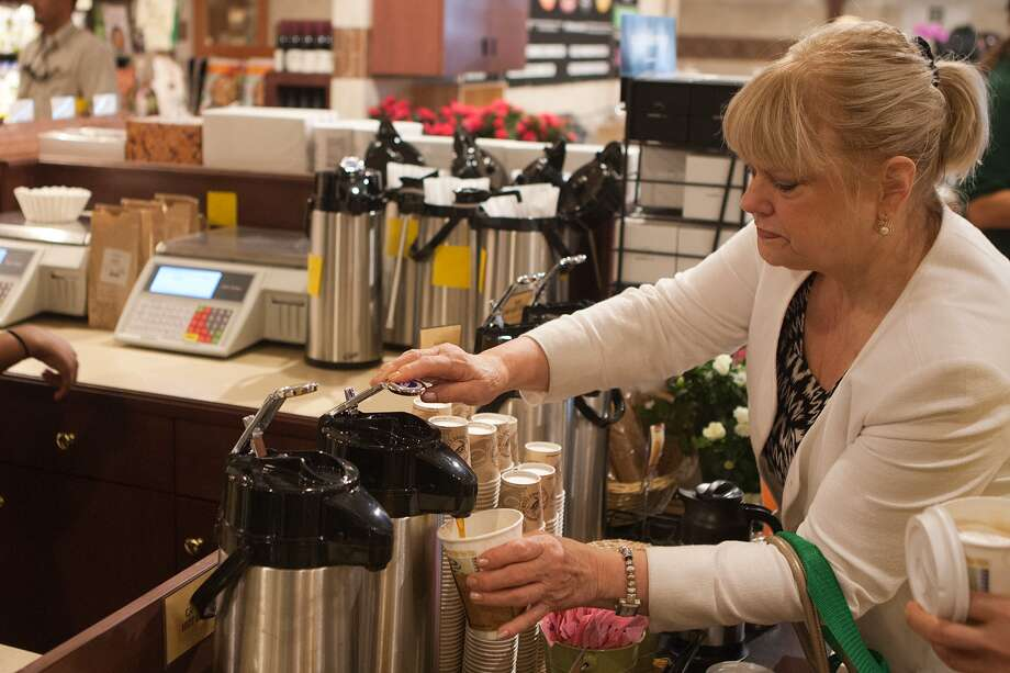 Lynn Rowan, 77057, goes straight for the coffeepot at the new Fresh Market on San Felipe near Post Oak.  (The old Rice Epicurean space.)  Photo By R. Clayton McKee Photo: R. Clayton McKee, For The Chronicle / © R. Clayton McKee