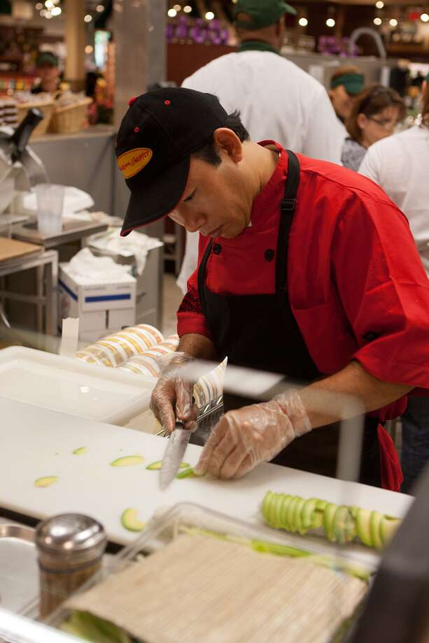 Sushi Chef Kyaw Myo preps an avocado-covered roll of some flavor at the new Fresh Market on San Felipe near Post Oak.  Photo: R. Clayton McKee, For The Chronicle / © R. Clayton McKee
