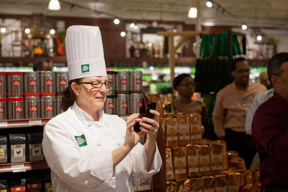 Chef Kerri Allee grabs a shot of the Parm Cracking at the new Fresh Market on San Felipe near Post Oak.   Photo: R. Clayton McKee, For The Chronicle / © R. Clayton McKee