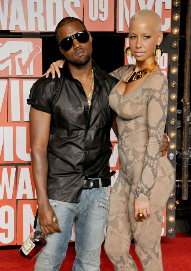 Amber Rose and Kanye West at the 2009 VMAs. Yes, this was the year West stormed the stage during Taylor Swift's acceptance speech. Wonder if that bottle of Hennessy he's carrying had something to do with that outburst? Photo: Gregg DeGuire, FilmMagic