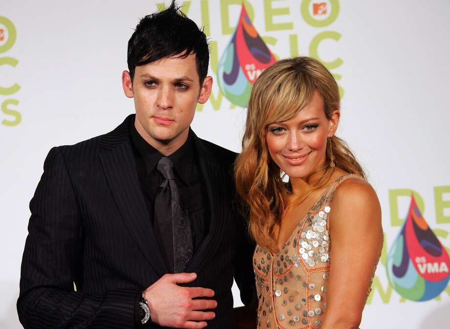 Good Charlotte's Joel Madden and actress Hilary Duff once dated (their relationship reportedly began when she was 16 and he was in his early 20s). Here they are at the VMAs in 2005. Madden is now married to Nicole Richie, while Duff is married to former hockey player Mike Comrie. Photo: Evan Agostini, Getty Images