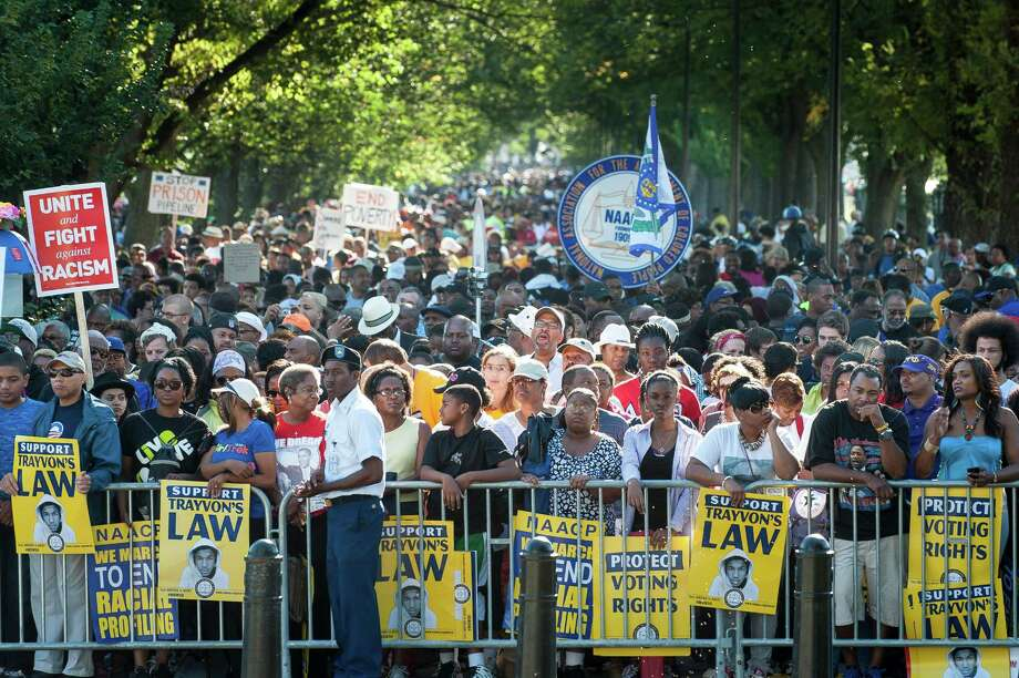 WASHINGTON, DC - AUGUST 24: People arrive at the National Mall to celebrate the 50th anniversary of the March on Washington and Dr. Martin Luther King, Jr.'s 'I have a Dream' speech on the National Mall on August 24, 2013 in Washington, DC. A commemorative march and a rally along the historic route followed in 1963 is led by civil rights leaders Al Sharpton and Martin Luther King III. Photo: Pete Marovich, Getty Images / 2013 Getty Images