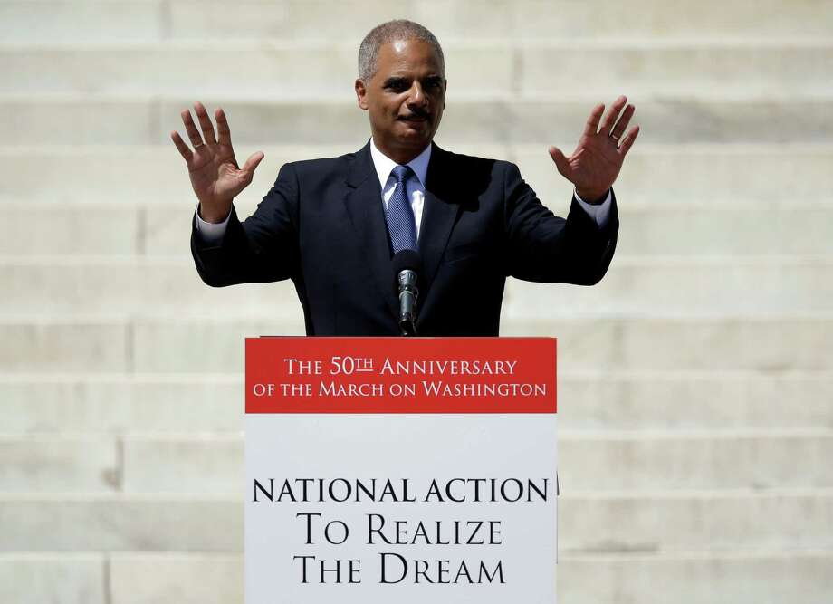 Attorney General Eri Holder acknowledges applause before speaking at a rally to commemorate the 50th anniversary of the 1963 March on Washington on the steps of the Lincoln Memorial on Saturday, Aug. 24, 2013, in Washington. Photo: Carolyn Kaster