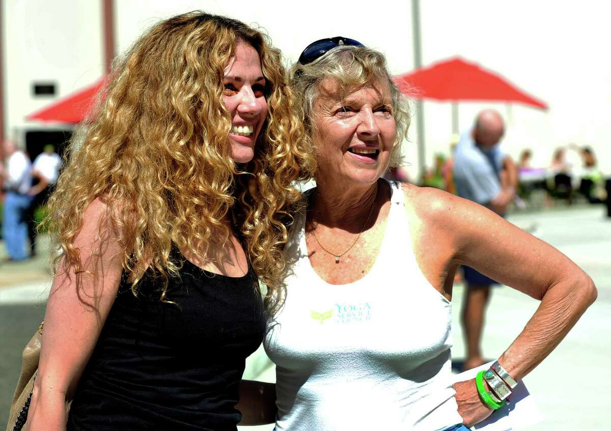 Seane Corn, left, and Beryl Bender Birch, renowned yoga instructors, lead the Newtown Yoga Festival sponsored by Sandy Hook Promise, at the Newtown Youth Academy Sports and Fitness Center, in Newtown, Conn. Saturday, Aug. 24, 2013.
