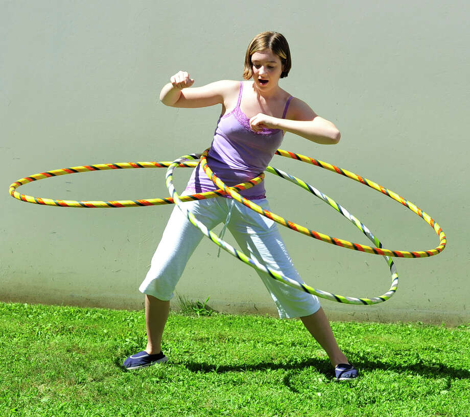 Hannah Mata, 13, attempts to hula multiple hoops at the Newtown Yoga Festival sponsored by Sandy Hook Promise, at the Newtown Youth Academy Sports and Fitness Center, in Newtown, Conn. Saturday, Aug. 24, 2013. Photo: Michael Duffy / The News-Times