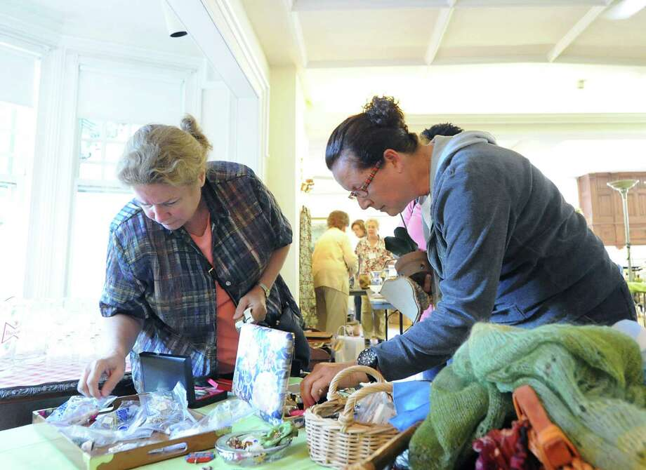 At right, Anita Kozminsky of Stamford, shops during the Woman's Club of Greenwich annual philanthropic tag sale at the club in Greenwich, Saturday morning, August 24, 2013. Club President, Trecie Fennell, said a good portion of the money raised from the sale will be used to fund scholarships awarded to Greenwich High School students headed to college. Photo: Bob Luckey / Greenwich Time