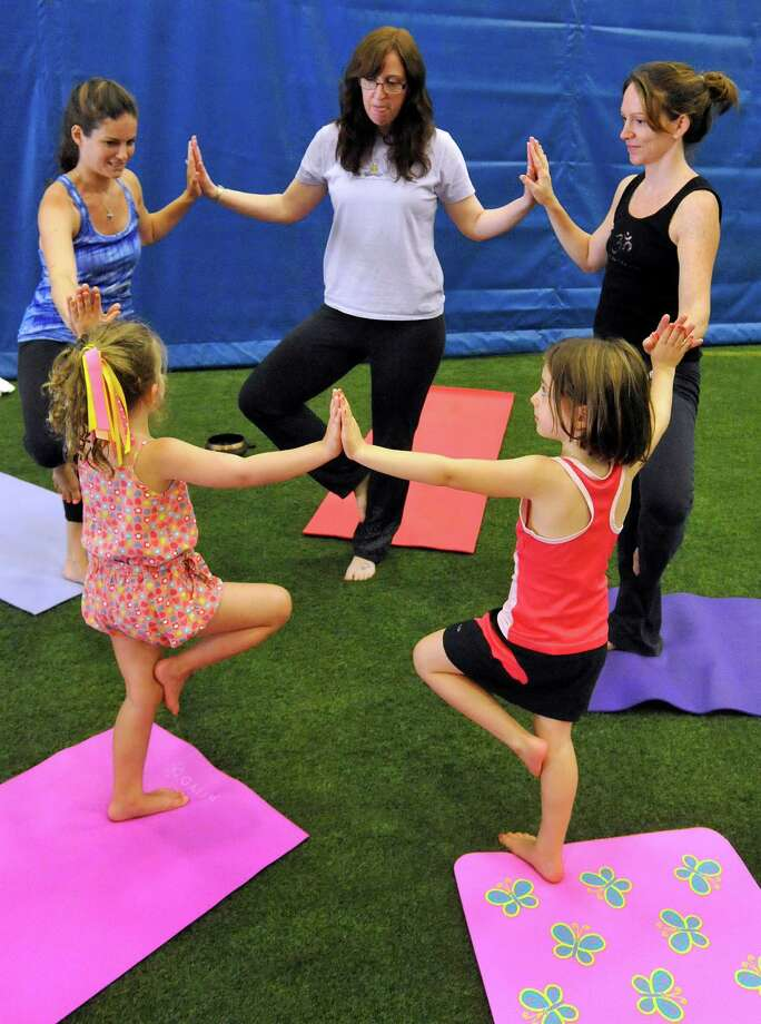 This is the Newtown Yoga Festival sponsored by Sandy Hook Promise, at the Newtown Youth Academy Sports and Fitness Center, in Newtown, Conn. Saturday, Aug. 24, 2013. Photo: Michael Duffy / The News-Times