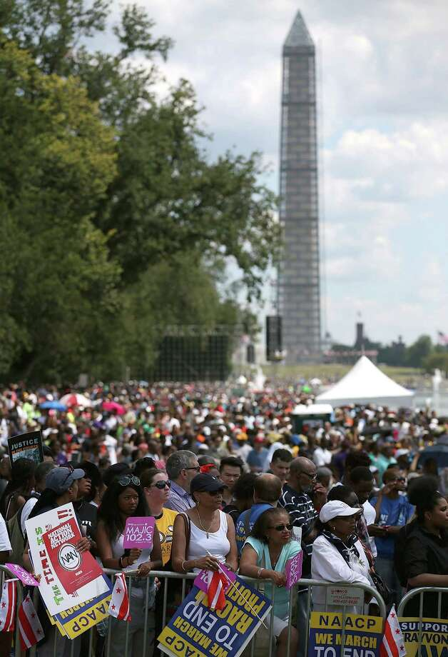WASHINGTON, DC - AUGUST 24: People gather for the 50th anniversary of the March on Washington and Dr. Martin Luther King, Jr.'s 'I have a Dream' speech at the Lincoln Memorial on August 24, 2013 in Washington, DC. The event included a commemorative march and rally along the historic route followed on August 28, 1963 and is being led by civil rights leader Al Sharpton and Martin Luther King III, King's oldest son. Photo: Mark Wilson, Getty Images / Getty Images