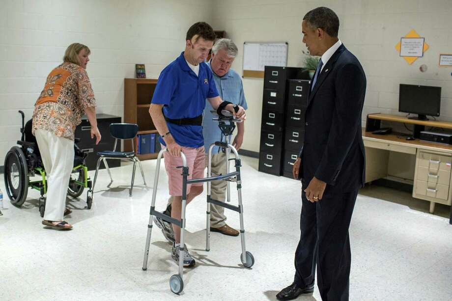 President Barack Obama meets privately with Sgt. 1st Class Cory Remsburg, the third time they've met, at a high school in Phoenix earlier this month. Obama's repeated encounters with Sgt. Remsburg stand out for bringing a president face to face with the resilience of the wounded and the brutal costs of U.S. wars. Photo: PETE SOUZA, HO / WHITE HOUSE PHOTO