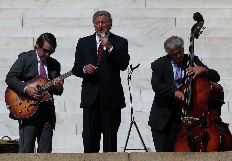 WASHINGTON, DC - AUGUST 24: Singer Tony Bennett (C) performs during the 50th anniversary of the March on Washington and Dr. Martin Luther King, Jr.'s 'I have a Dream' speech at the Lincoln Memorial on August 24, 2013 in Washington, DC. The event included a commemorative march and rally along the historic route followed on August 28, 1963 and is being led by civil rights leader Al Sharpton and Martin Luther King III, King's oldest son. Photo: Mark Wilson, Getty Images / Getty Images