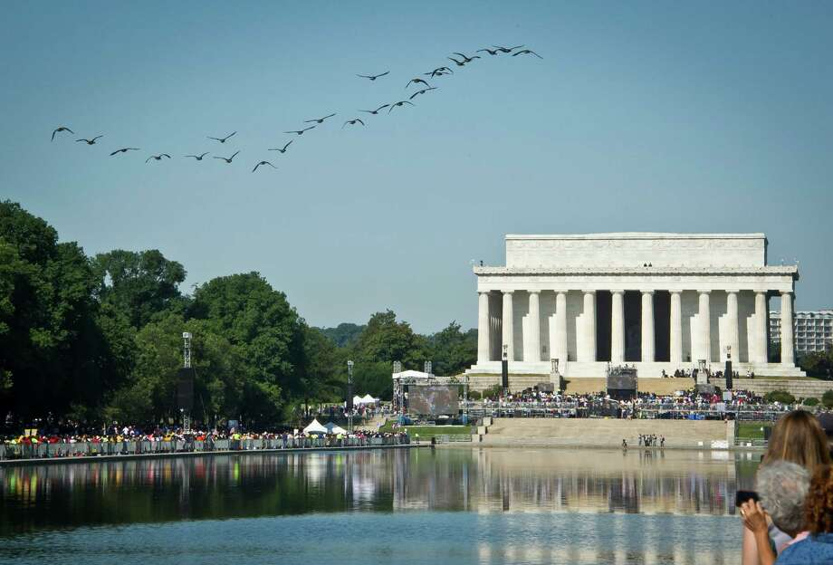 "Wild geese fly over the reflecting pool near the Lincoln Memorial while thousands of people gather to commemorate the 50th anniversary of the March on Washington and Dr. Martin Luther King, Jr.'s ""I have a Dream"" speech on August 24, 2013, in Washington, DC.    AFP PHOTO/MLADEN ANTONOV Photo: MLADEN ANTONOV, AFP/Getty Images / Getty Images"