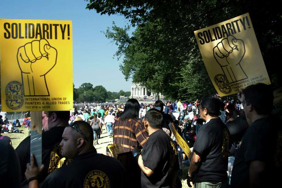 "People carry posters as thousands gather to commemorate the 50th anniversary of the March on Washington and Dr. Martin Luther King, Jr.'s ""I have a Dream"" speech on August 24, 2013, near the Lincoln Memorial in Washington, DC. AFP PHOTO/MLADEN ANTONOV Photo: MLADEN ANTONOV, AFP/Getty Images / Getty Images"