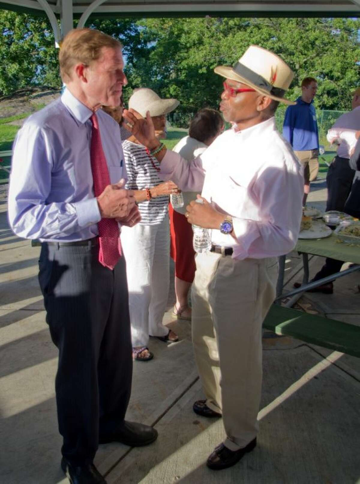 U.S. Sen. Richard Blumenthal speaks to Paul Lowe at theGreenwich Chamber of Commerce annual picnic held at Byram Park on Aug. 14.