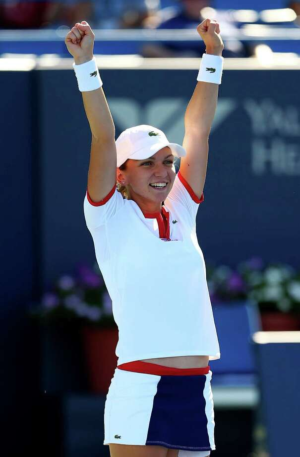 NEW HAVEN, CT - AUGUST 24:  Simona Halep of Romania celebrates match point giving her the win over Petra Kvitova of the Czech Republic in the Women's Final on Day Seven of the New Haven Open at Yale at the Connecticut Tennis Center on August 24, 2013 in New Haven, Connecticut. Photo: Elsa, Getty Images / Getty Images