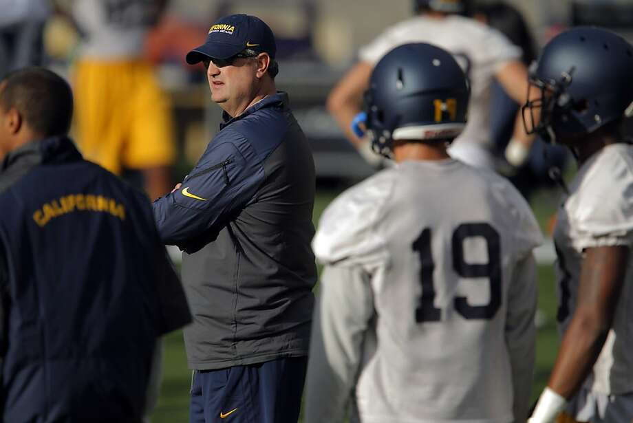 Cal's head coach Sonny Dykes watches practice at Memorial Stadium in Berkeley, Calif., on Tuesday, August 6, 2013. Photo: Carlos Avila Gonzalez, The Chronicle