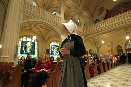 Sister Theresa Gossen takes part in a procession before telling some of story of the Sisters of Divine Providence and the Missionary Catechists of Divine Providence at the 250th anniversary celebration of the groups. The celebration was held at Sacred Heart Conventual Chapel at Our Lady of the Lake University. Other groups from Belgium and France were also included in the celebration. (Sunday January 15, 2012) JOHN DAVENPORT/jdavenport@express-news.net Photo: JOHN DAVENPORT, San Antonio Express-News / SAN ANTONIO EXPRESS-NEWS (Photo can be sold to the public)
