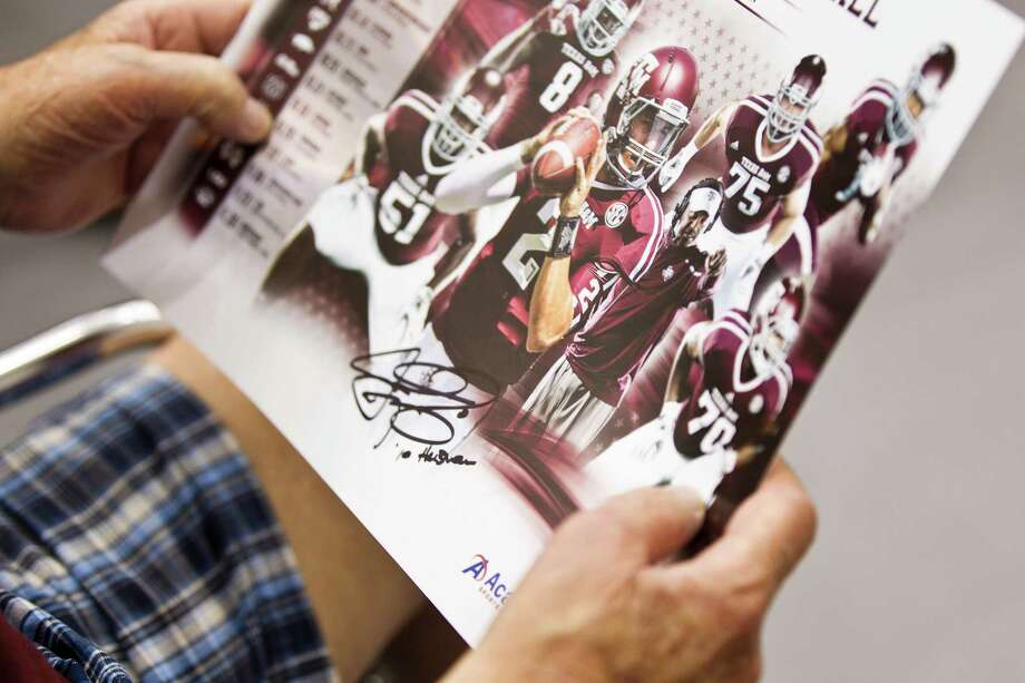 "Texas A&M quarterback Johnny Manziel's autograph is shown on a poster during the ""Meet the Aggies"" event. Photo: Brett Coomer, Houston Chronicle / © 2013 Houston Chronicle"