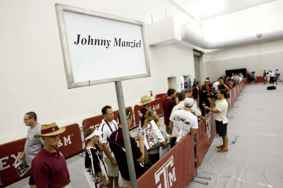 "Texas A&M football fans line up for an autograph from quarterback Johnny Manziel during the ""Meet the Aggies"" event. Photo: Brett Coomer, Houston Chronicle / © 2013 Houston Chronicle"
