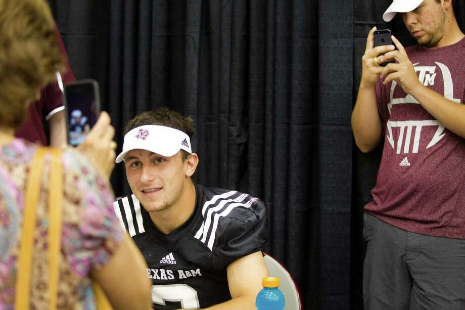 "Texas A&M football fans take pictures of quarterback Johnny Manziel during the ""Meet the Aggies"" event. Photo: Brett Coomer, Houston Chronicle / © 2013 Houston Chronicle"