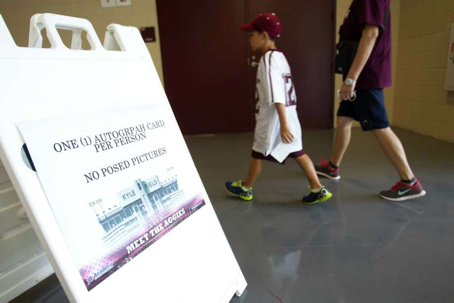 "A sign describing autograph restrictions for ""Meet the Aggies"" is posted. Photo: Brett Coomer, Houston Chronicle / © 2013 Houston Chronicle"