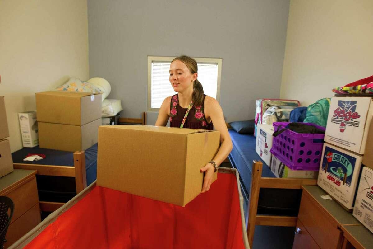 Freshman Haley Thomas unpacks Thursdya during move-in day at Cougar Village II at the University of Houston.