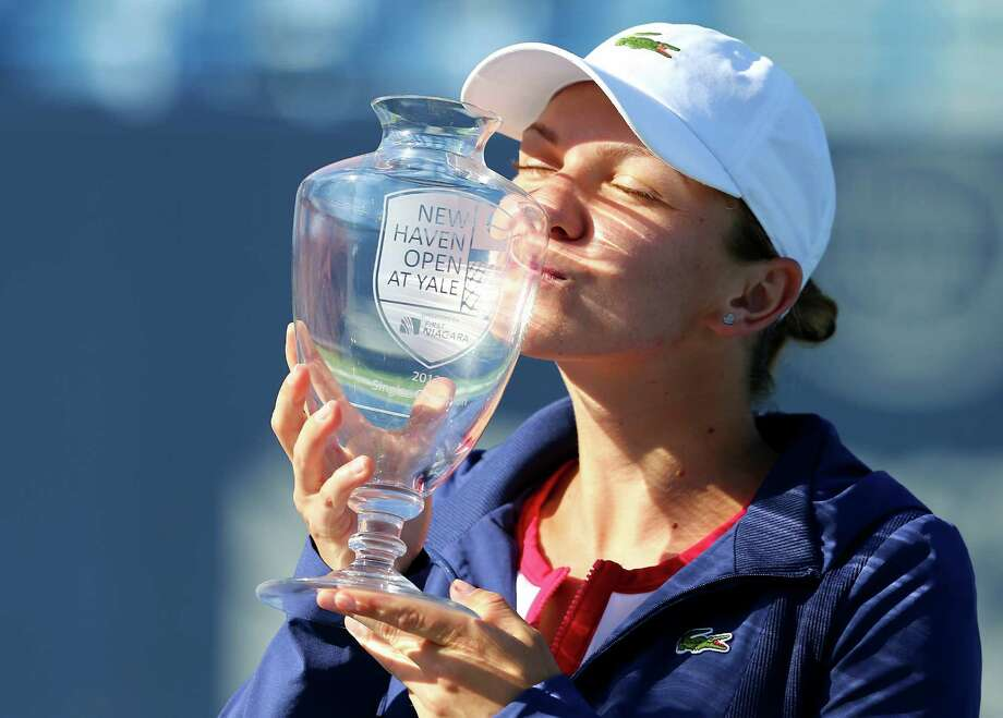 NEW HAVEN, CT - AUGUST 24:  Simona Halep of Romania kisses the trophy after she defeated Petra Kvitova of the Czech Republic in the Women's Final on Day Seven of the New Haven Open at Yale at the Connecticut Tennis Center on August 24, 2013 in New Haven, Connecticut. Photo: Elsa, Getty Images / Getty Images