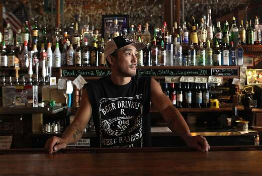 Chris Loh runs the Iron Door Saloon in Groveland, a Sierra foothills town that relies on the thousands of tourists pouring through on their way to Yosemite during the summer. Photo: Michael Macor, San Francisco Chronicle