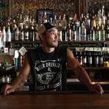 Chris Loh runs the Iron Door Saloon in Groveland, a Sierra foothills town that relies on the thousands of tourists pouring through on their way to Yosemite during the summer.